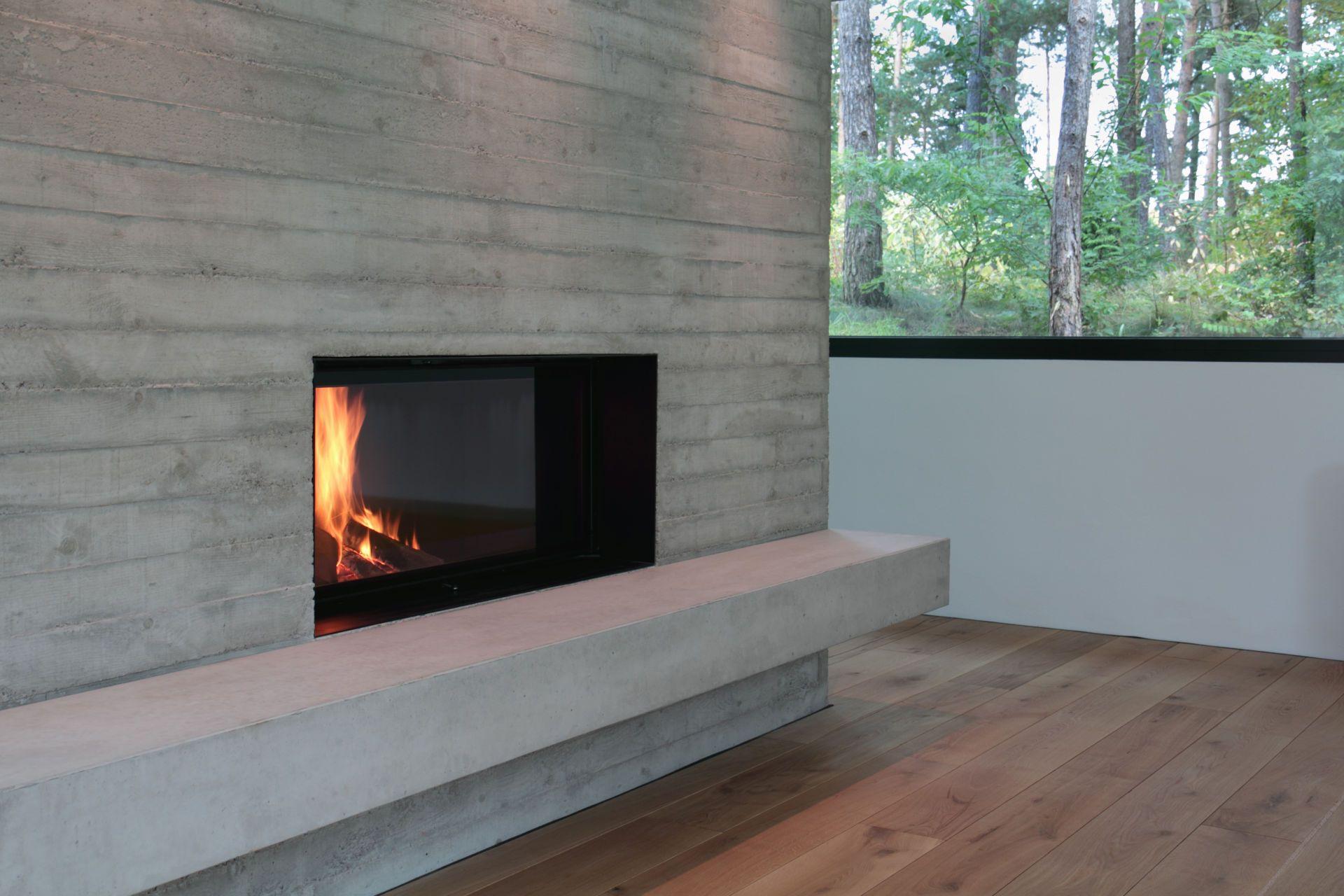 puristischer kamin in sichtbeton wand. Black Bedroom Furniture Sets. Home Design Ideas