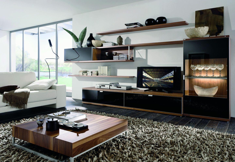 wohnzimmer mit schwarzen m bel fronten. Black Bedroom Furniture Sets. Home Design Ideas
